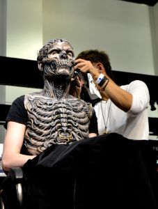 Makeup artist works on his project - Photo by Craig Hammons